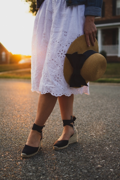 Close up of white skirt, hat and shoes.